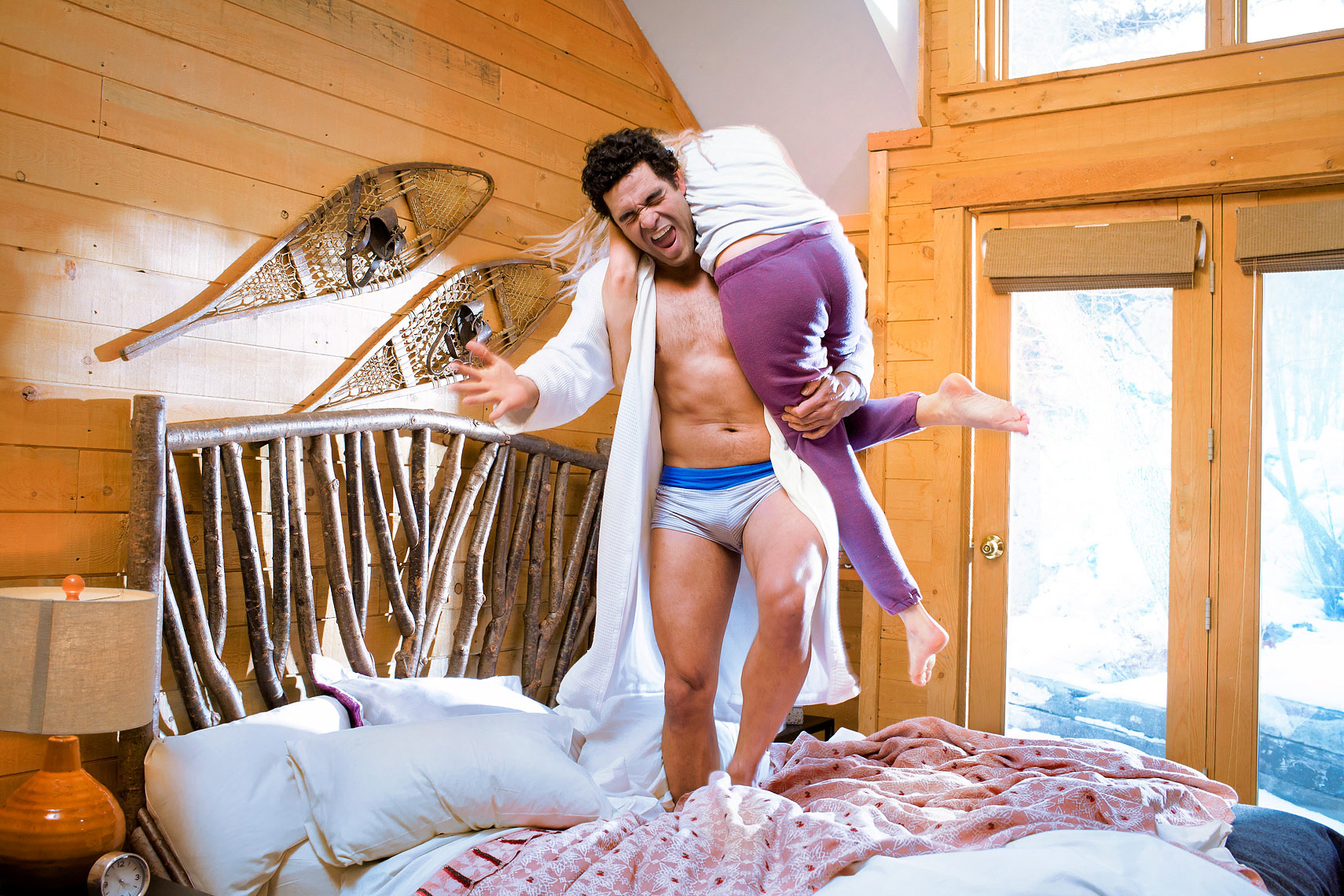 lifestyle-photograph-of-couple-jumping-on-bed-ann-arbor-commercial-photographer-scott-stewart