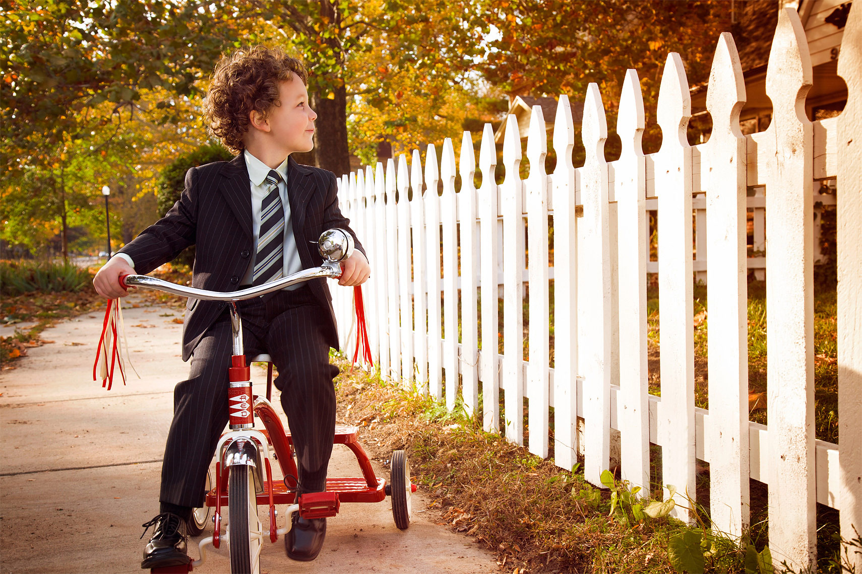 scott-stewart-lifestyle-portrait-child-riding-tricycle-ann-arbor-commercial-photographer